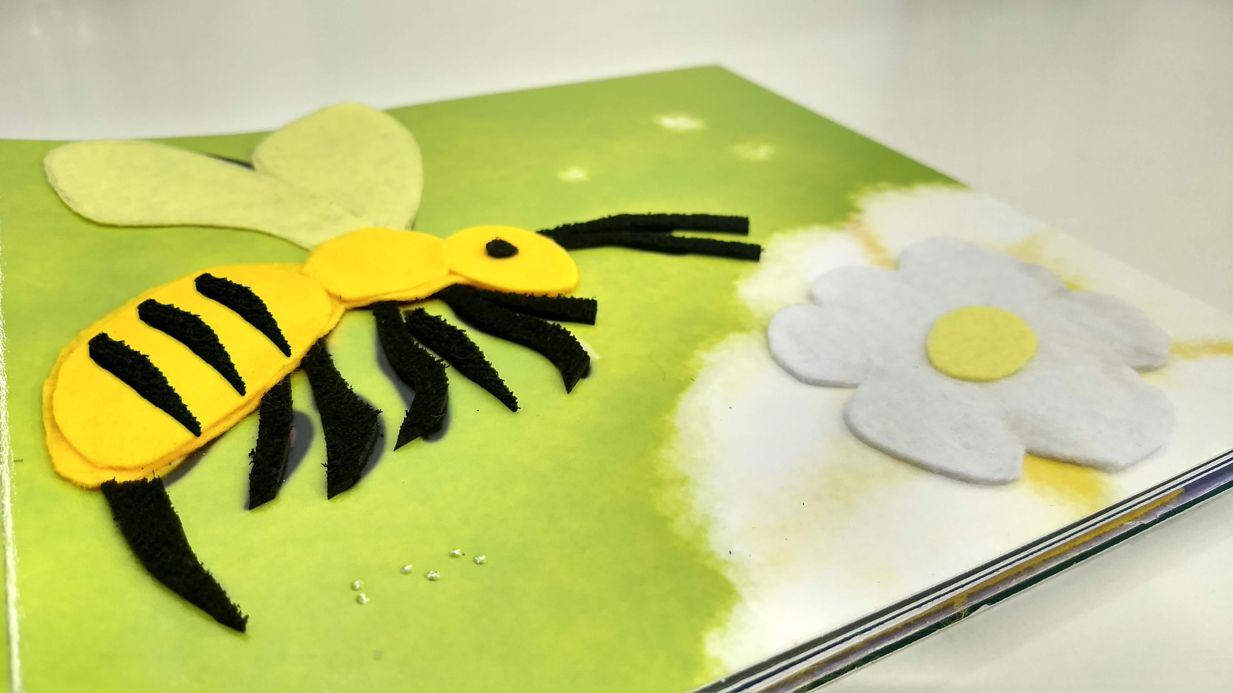 tactile image of a bee on a page from our book - what makes you special